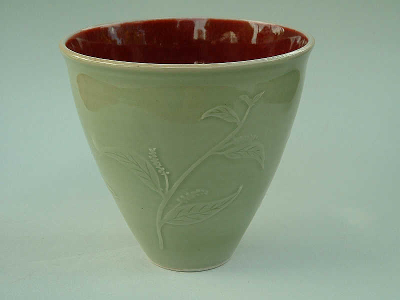 Pot with copper red               and water-etched celadon