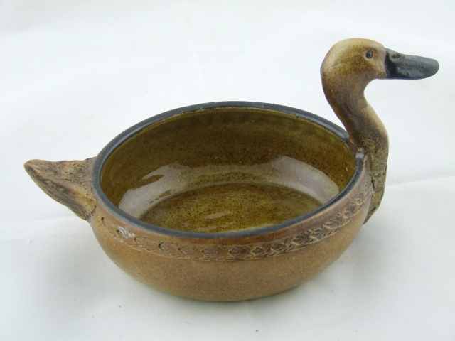 Oval dish with duck               head and tail