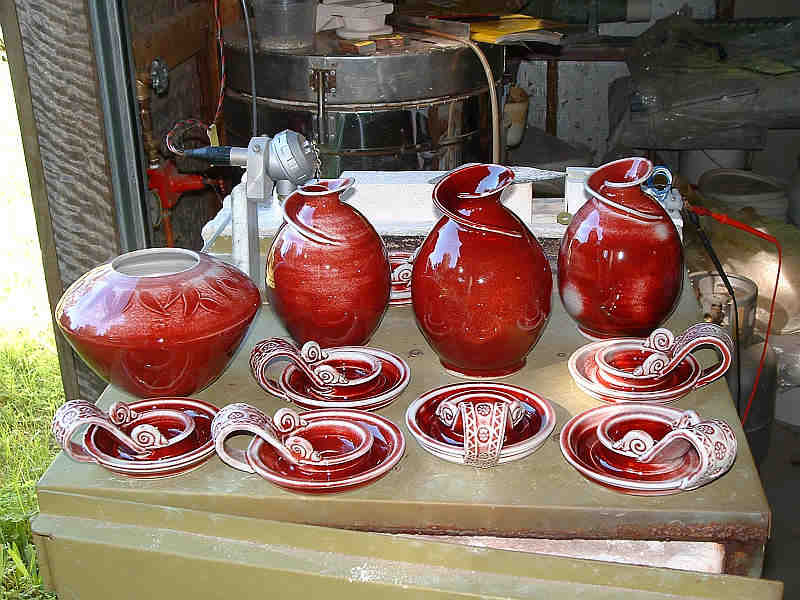 Group of               copper red pots