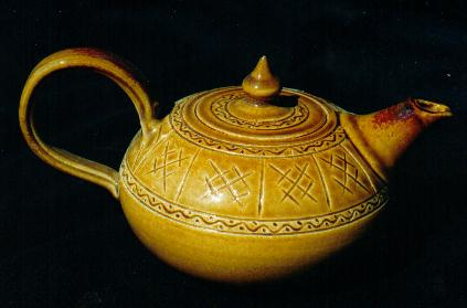 Teapot                       06, sgraffito pattern and honey glaze