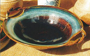 Twisty-handle bowl in temmoku glaze